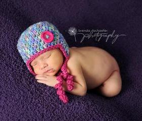 Baby girl earflap hat with button in multicolor and hot pink